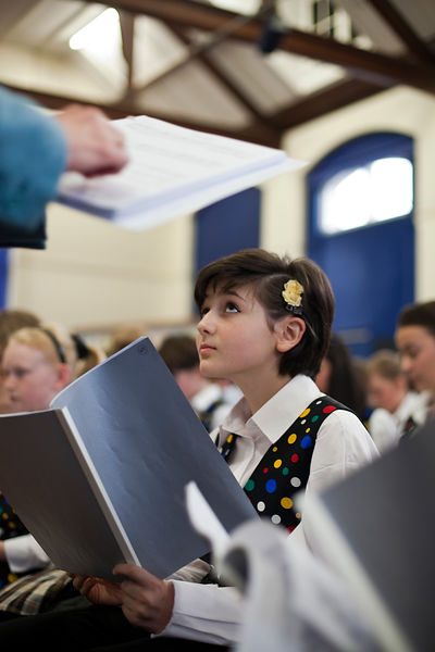 UK - Scunthorpe - Schoolgirls chosen for the choir as part of the production of Cycle Opera practice for the first time in co...