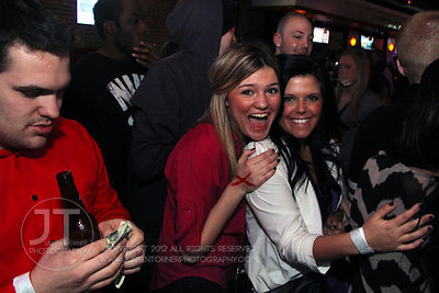 Bar patrons react to the camera at the Airliner Bar, 22 S Clinton Street in downtown Iowa City Saturday night. Copyright Just...