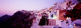 View of the village of Fira on Santorini island during sunset.