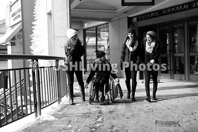 Teenage girl using a wheelchair out Christmas shopping with her friends on a cold winters day