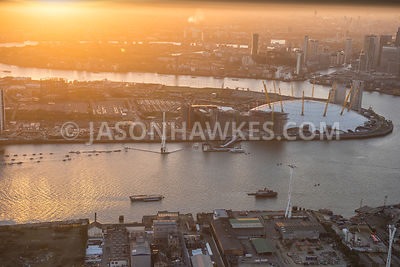 Aerial view of London, Greenwich Peninsula from The Royal Docks, evening.