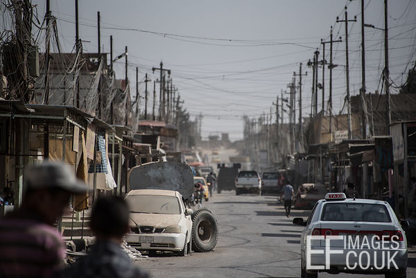 Taxi Drivers and civilians are repopulating West Mosul streets still filled with abandoned vehicles. Mosul, Iraq, 5th June 2017