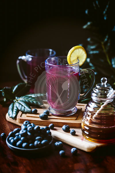 A glass of blueberry hot toddy