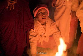 Novice nuns sit around fire at Htet Eain Cave Monastic Education Schools near Nyaungshwe in Myanmar.