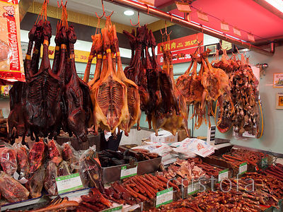 a large selection of food in the markets including these Peking ducks