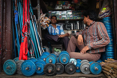 Two men tend a small sporting goods shop in SIon, Mumbai, India.