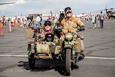 Two gentlemen, a motorbike and sidecar