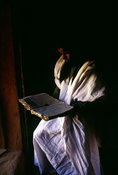 Mauritania - Chinguetti - A librarian in an ancient library, reads an ancient book in Chinguetti