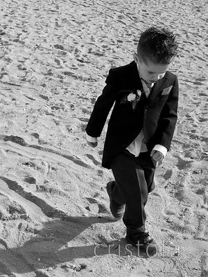 a young man on a beach dress for a wedding in Falmouth