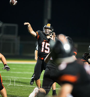 Solon's Cam Miller (15) launches a touchdown pass to Ben Krutzfeldt (3) during the second half of play in Solon on Friday, Se...