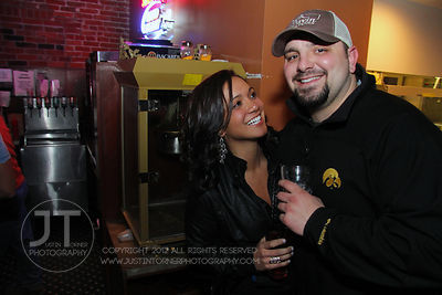 Bar patrons Lindsey Reed and Aric Kos react to the camera at the Airliner Bar, 22 S Clinton Street in downtown Iowa City Satu...