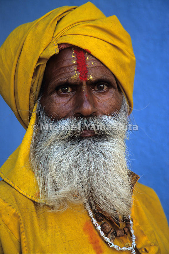 A Sadhu, or holy man poses for a portrait. These ascetics who worship Shiva, renounce worldly goods in their goal to achieve ...