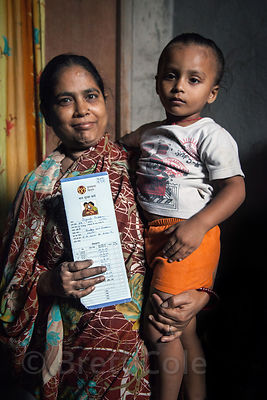 Mother and son at the Swastha Kendra Clinic operated by the NGO Calcutta Kids (calcuttakids.org), in the Fakir Bagan area of ...