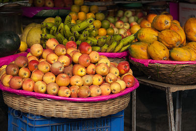 Fruit for sale at a sidewalk market stall, Newmarket, Kolkata, India.