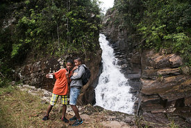 "Children take a ""selfie"" in front of a waterfall in the Vohimana reserve located near the Andasibe National Park on June 5, 2..."