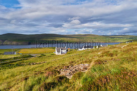 White painted houses of Milovaig overlooking Loch Pooltiel near Dunvegan on the Isle of Skye, Scotland, UK.