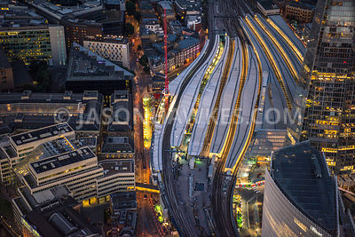 Aerial view of London, Borough with London Bridge Station roof tops with The Shard at night.