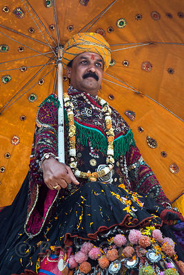 Man dressed for a parade marking Katrik Purnima, Pushkar, Rajasthan, India