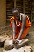 Kalenjin girl grinding maize, Ngomongo Village, Kenya