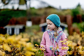 Little Danish girl in a blue hat in autumn 1