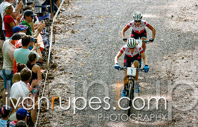 Catharine Pendrel (1) and Emily Batty lead the women's MTB XCO race from start to finish, Batty eventually taking the gold, T...