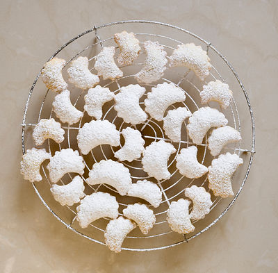 crescent shaped, white christmas cookies
