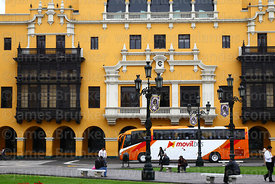 Tour bus in front of the Club Union building, Lima, Peru