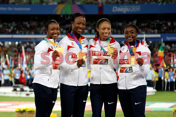 The Usa 4x100 relay team at the podium with the gold medals,2011 IAAF World Championships,Athletics,Daegu,S.Korea