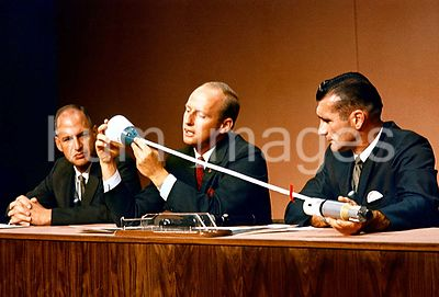 26 Sept. 1966) --- Astronaut Charles Conrad Jr. (center), Gemini-11 prime crew command pilot, discusses the Gemini-11Agena te...