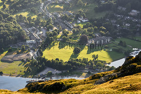 Sun setting over Lake District village of Glenridding at sunset. UK.