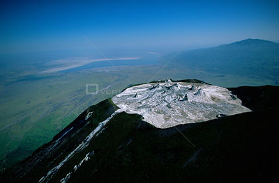 Aerial view of Ol Doinyo Lengai Crater (The Mountain of God) Rift Valley, Tanzania. Note- small cones on crater floor formed ...