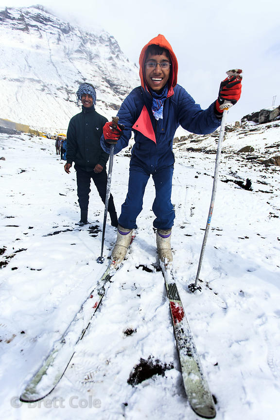 An Indian tourist skis at Snow Point on the summit of Rohtang Pass, Manali, India