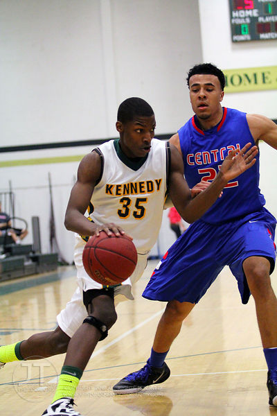 Cedar Rapids Kennedy's Josiah Coleman (35) drives past Davenport Central's Zach Burnham (22) in the first half of play. The N...