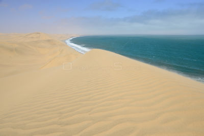 Atlantic ocean and coastal dunes of the Namib Desert. Namib Naukluft National Park, Namibia, September 2013.