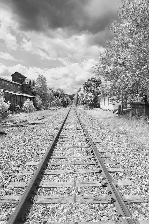 RAILTRACK AND OLD BUILDINGS RANDOLPH VERMONT BLACK AND WHITE VERTICAL