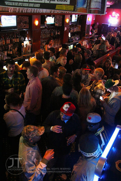 Bar patrons fill the Airliner Bar, 22 S Clinton Street in downtown Iowa City Saturday night. Copyright Justin Torner 2012 htt...