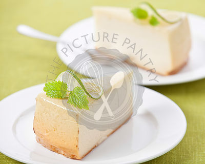 Classical Cheesecake on plate on green texture background