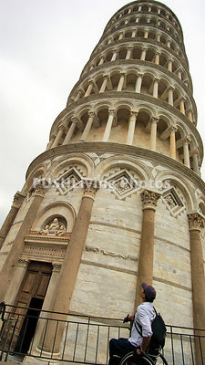 Man using a wheelchair on holiday in Italy at the leaning tower of Pisa