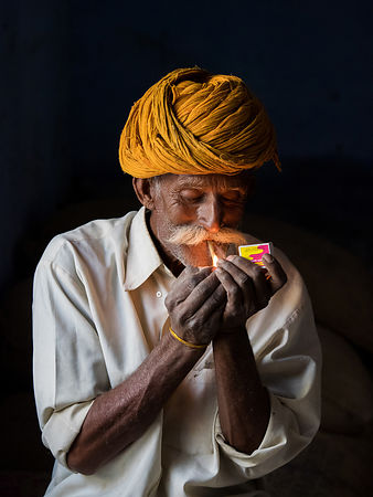 This portrait of an old man lighting his cigarette was shot in a village in Jojawar.