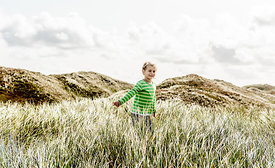 Danish girl playing in the dunes in Thy 2