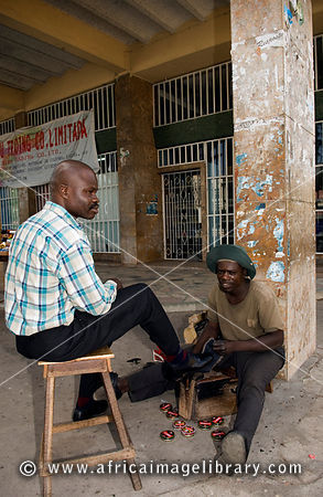 Mozambique, Beira, shoe-shiner on Municipal Square.