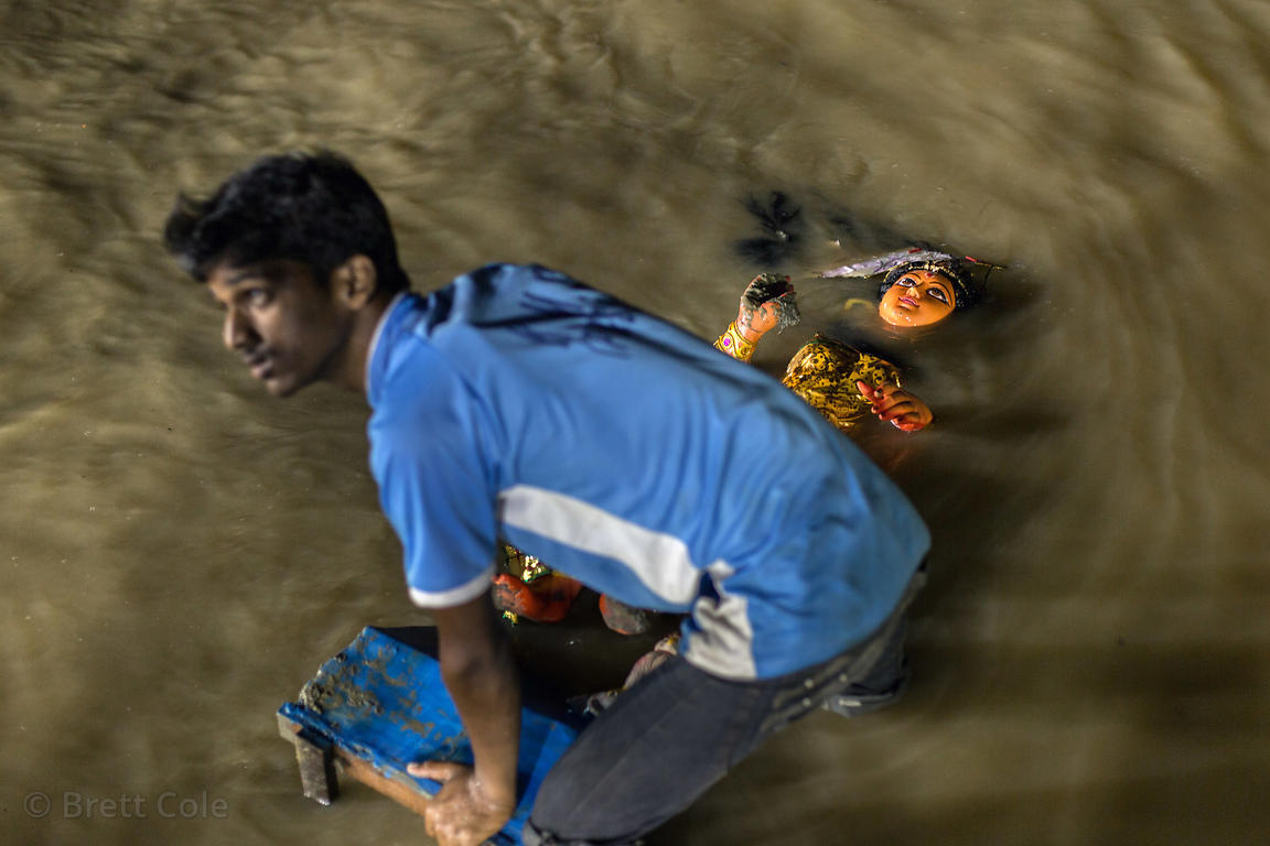 Durga idols are recovered from the Hooghly River after being immersed during the Durga Puja idols, Babughat, Kolkata, India. ...