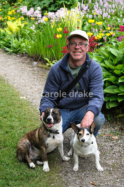 Sean Heffernan, head gardener at Mount Usher, with his dogs Minnow and Mitch.
