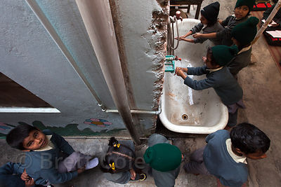 Students wash their hands before eating at a school in Varanasi, India operated by Dutch NGO Duniya (duniya.org).