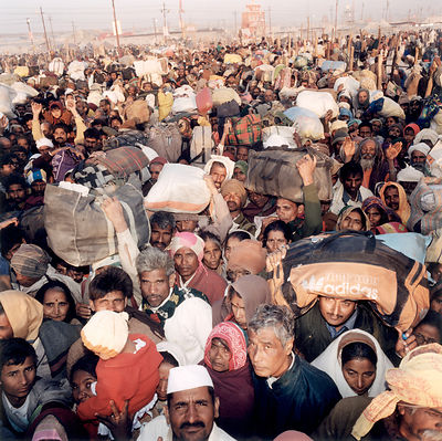 Pilgrims crowd onto a bridge as they queue to leave the hold site at the Kumbh Mela