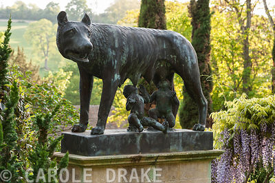 Bronze cast of Wolf suckling Romulus and Remus made from original in Capitol Museum in Rome. Iford Manor, Bradford-on-Avon, W...