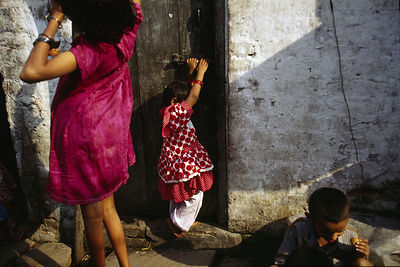 India - New Delhi - Children play in the alleyways of the Shadipur slum