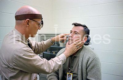(21 March 1965) --- Astronaut John W. Young, pilot for the Gemini-Titan 3 mission, undergoes an ear, nose and throat examinat...