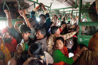 Pilgrims crowd a train heading south from Sealdah station in Kolkata, India to Kakdwip station near Sagar Island, for the Gan...