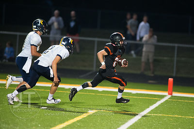 Solon's Hunter Kula (28) runs in for a touchdown against Iowa City Regina during the first half of play in Solon on Friday, S...
